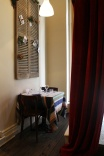 Dining under French shutters